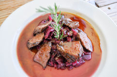 Kangaroo Meat. Cooked kangaroo meat with braised red cabbage Stock Photography