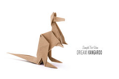 A kangaroo origami. Kraft paper on a white background Stock Images