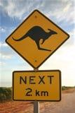 Kangaroo warning sign. Kangaroos next 2 km sign in the Australian outback Royalty Free Stock Image