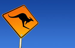 Kangaroo Warning Sign (with Path). Kangaroo road warning sign, with brilliant blue Australian desert sky behind.  Clipping path included Stock Image