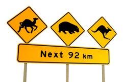 Kangaroo, wombat and camel warning sign Australia. Isolated on a white background Royalty Free Stock Photography