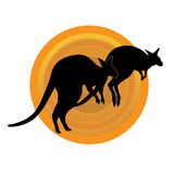 Kangaroos Running. A silhouette of a pair of kangaroos running against a stylized aboriginal patterned circle Stock Photo
