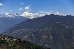 Kangchenjunga mountain with clouds above and mountain`s villages that view in the morning in Sikkim, India. Stock Image