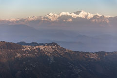 Kangchenjunga mountain in the morning with blue and orange sky and mountain villages that view from The Tiger Hill in winter. Kangchenjunga mountain in the Royalty Free Stock Image