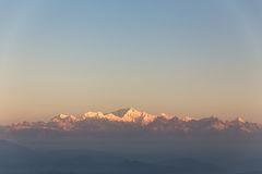 Kangchenjunga mountain in the morning with blue and orange sky that view from The Tiger Hill in winter at Tiger Hill, Darjeeling. India Stock Photo