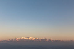 Kangchenjunga mountain in the morning with blue and orange sky that view from The Tiger Hill in winter at Tiger Hill, Darjeeling. India Royalty Free Stock Images
