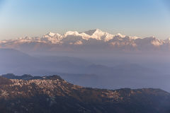 Kangchenjunga mountain in the morning with blue and orange sky and mountain villages that view from The Tiger Hill in winter. Stock Photos