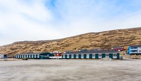 Kangerlussuaq settlement with small living Inuit houses in the v. Alley on the hills, Greenland Stock Image
