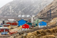 Kangerlussuaq settlement with streets and living houses in the v. Alley among mountains, Greenland Royalty Free Stock Photography