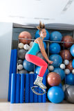 Kangoo Jumps Anti Gravity fitness boots girl. Kangaroo jumps anti gravity fitness boots girl at gym indoor royalty free stock photos