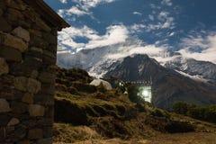 Kangtega mountain night peaks, Phortse village, Nepal. Night over Phortse village, Kangtega mountain snow peaks stars sky. Long exposure photography. Everest Royalty Free Stock Image