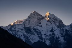 Kangtega mountain peak in a morning sunrise, Everest region trek. Nepal, Asia stock photo