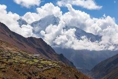 Kangtega mountain snow peaks, farm village buildings, Nepal. Stock Photography