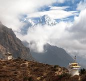 Kangtega and Thamserku near Namche Bazar with stupas Royalty Free Stock Photos