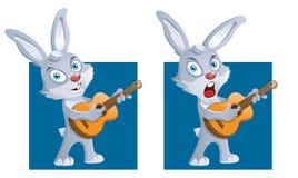 Kanin med en gitarr Arkivbild