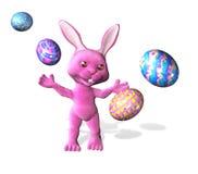 kanin som fäster den färgrika easter äggbanan ihop Fotografering för Bildbyråer