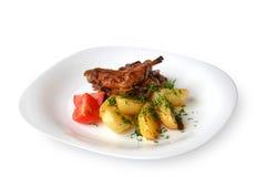 Kanin som låtas småkoka med grönsaker Fotografering för Bildbyråer
