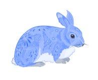 Kanin som målas som påskägg Arkivbild