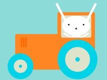 Kanin som rider en traktor royaltyfri bild