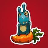 Kaninchen auf großer Karotte Lizenzfreie Stockfotos