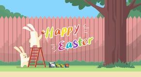 Kaninchen-Gruppe, die auf Bockleiter-Griff-Bürsten-Farben-glücklicher Ostern-Wand-Feiertags-Fahne steht Stockbilder