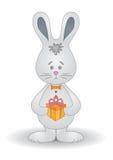 Kaninchen mit einem Geschenk Stockbilder