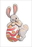 Kaninchen mit Osterei lizenzfreie abbildung