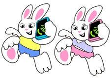Kaninchen mit Telefon Stockfotos