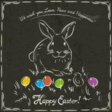 Kaninchen und Ostern färbten Eier auf Schmutzbraunhintergrund Stockfotografie
