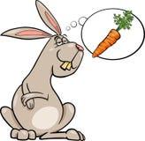 Kaninchentraum über Karottenkarikatur Stockbild