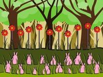 Kaniner på gräs Arkivbild