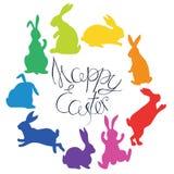 Kaninkonturer i regnbåge färgar ordnat i en cirkel lyckliga easter Arkivbilder