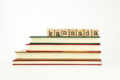 Kannada language word on wood stamps and books Stock Images
