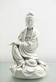 Kannon statue. White china kannon statue close up Royalty Free Stock Photo