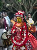 Theyyam Ceremony in Kerala state, South India. KANNUR, INDIA - JANUARY 15, 2016: Indian man conducts Theyyam ceremony. Theyyam is a ritualistic folk art form of Stock Photos