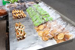 Thai sweetmeat and pancake for sell at Bangrak, Bangkok, Thailand. Kanom Bueang is Thai traditional sweetmeat made from mung bean flour, egg and crème. There Stock Photos