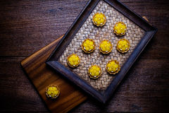 Kanom Jamongkut is a kind of crown-like yellow sweetmeat mainly. Made of yolk and sugar. thai dessert Stock Image