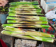 Kanom Jark. Is Thai sweetmeat made of flour, coconut and sugar wrap with nipa palm leaf Royalty Free Stock Photo