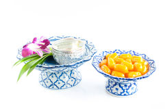 Kanom med Kanoon on white background. The Thai desserts from Thai green peanut paste stock photos