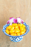 Kanom med Kanoon on wood background. The Thai desserts from Thai green peanut paste royalty free stock image