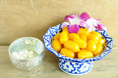 Kanom med Kanoon on wood background. The Thai desserts from Thai green peanut paste royalty free stock photography