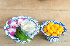 Kanom med Kanoon on wood background. The Thai desserts from Thai green peanut paste Royalty Free Stock Images