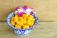 Kanom med Kanoon on wood background. The Thai desserts from Thai green peanut paste Royalty Free Stock Photos