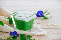 `Kanom Peak Poon Bai Tuey Kati Sod` Thai Sweet. Sweet Pudding, Natural Green Color From Pandan Leaf And Topping With Coconut Milk Cream And Saseme stock images