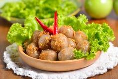 Kanom sago; Thai dessert ; powdery starch from certain sago palm. S stuff with pork Stock Images