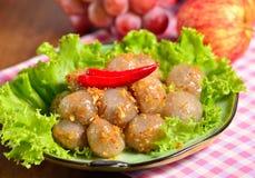Kanom sago; Thai dessert ; powdery starch from certain sago palm. S stuff with pork Stock Image