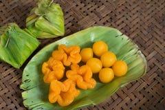 Kanom Thong Yod and kanom thong yib a traditional Thai dessert. Kanom thaong yod and kanom thaong yib on banana leaf Royalty Free Stock Image