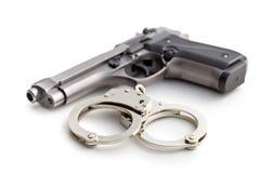 Kanon en handcuffs stock afbeelding