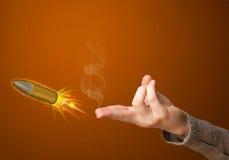 Kanon gevormde vrouwenhand met kogel Stock Foto