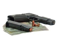 Kanon, kogels en geld op de witte achtergrond Royalty-vrije Stock Foto's